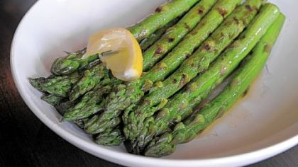 """The best dishes are simple, focusing on a few good ingredients A side of grilled asparagus was perfectly cooked, generously dressed with olive oil and lemon that pooled onto the plate."""