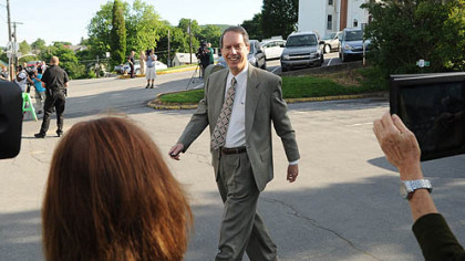 Attorney for Jerry Sandusky, Joe Amendola smiles as he walks into the courthouse for the fourth day of Sandusky's trial at the Centre County Courthouse Thursday.
