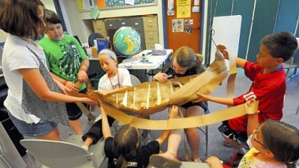 Fourth-grade students in Martin Richter?s class (from left: Abigail Begler, Zack Dickinson, Jenna Pieretti, Rebekah Froehlich, Nadia Huebner, Ethan Vechi and Bethany Wittig) at West View Elementary School made a replica of a Viking longboat. They are finishing a second one as the school year ends. West View Elementary is in the North Hills School District.