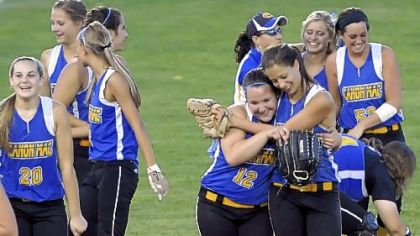 Canon-McMillan teammates celebrate their WPIAL title game victory against Hempfield on May 31.