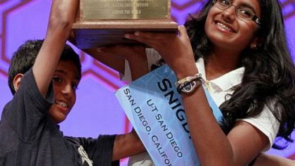 "Fourteen-year-old Snigdha Nandipati and her brother Sujan hoist her trophy after she won the National Spelling Bee last month by spelling the word ""guetapens,"" which means ""trap"" or ""snare."""