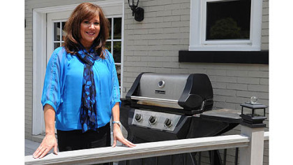 "Bellevue recently passed an ordinance banning grilling within 5 feet of a home. Bellevue Councilwoman Kathy Coder opposes the rule. On Friday, she posed by her grill -- which is closer than 5 feet to her home. ""I don't know what I'm going to do,"" she said."