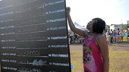 Shawnee Wright, a Hazelwood resident for 11 years, writes out what she wants to change in Hazelwood.