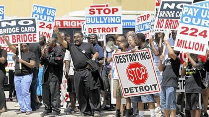 People in Detroit protest a new bridge on Friday that will be built between Ontario and Detroit.