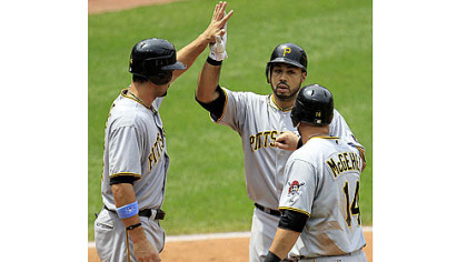 The Pirates' Pedro Alvarez, center, is congratulated by teammates Garrett Jones, left, and Casey McGehee after hitting a three-run home run off Cleveland Indians starting pitcher Jeanmar Gomez in the fourth inning.
