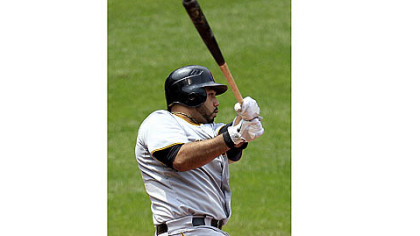 The Pirates' Pedro Alvarez watches his ball after hitting a three-run home run off Cleveland Indians relief pitcher Esmil Rogers in the fifth inning.