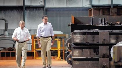 Republican presidential candidate, former Massachusetts Gov. Mitt Romney speaks with Mike Leib, the president of Weatherly Casting Co., as he is given a tour during a campaign stop Saturday in Weatherly, Pa. Mr. Romney continues his campaign swing through battle ground states as he battles President Barack Obama for votes.