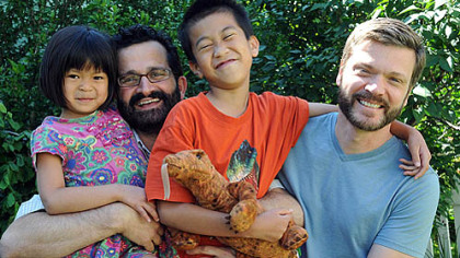 Ray Yeo and Mark Friedman with their kids, Lilly and Ben.