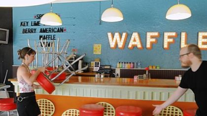 Courtney Ehrlichman and Robert Sayre arrange the stools at the Waffle Shop in East Liberty, next to Conflcit Kitchen.