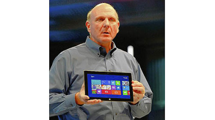 Microsoft CEO Steve Ballmer shows the Surface tablet Monday during a news conference in Los Angeles.