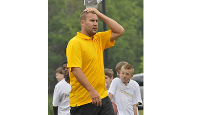 Steelers quarterback Ben Roethlisberger watches youths work out at his football camp.