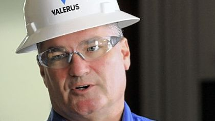 Valerus regional vice president Chris Scheve talks about safety precautions during a media tour. Left, an electronic sign updates consecutive safe days.