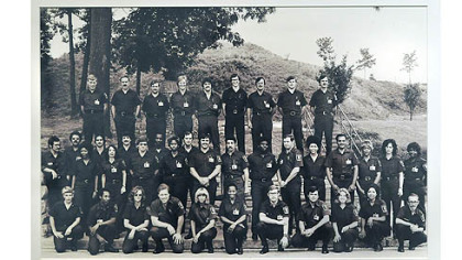 A photograph at August Wilson Center exhibit showing the Allegheny County Police Academy's 1976 cadet class, its first including women.