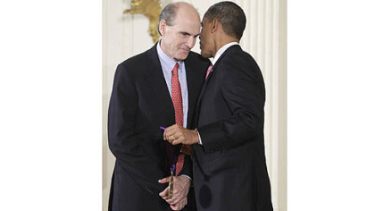 President Barack Obama presents a 2010 National Medal of Arts to Mr. Taylor on March 2, 2011, during a ceremony in the East Room of the White House in Washington.