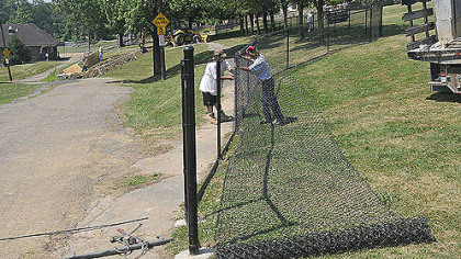 Workers from Allegheny Fence work on the new dog park at Olympia Park on Mount Washington today.