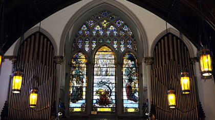 One of the Tiffany windows at Calvary United Methodist Church on the North Side depicts the apostle John and images from The Book of Revelation.
