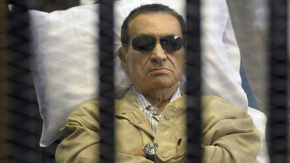 Hosni Mubarak sits inside a cage in a Cairo courtroom June 2, when he was sentenced to life in prison.