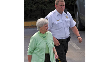 Dottie Sandusky leaves the Centre County Courthouse after testifying on behalf of her husband, Jerry, during his trial Tuesday afternoon.