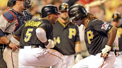 Josh Harrison greets Andrew McCutchen at home after McCutchen hit a two-run home run to put the Pirates ahead, 6-2, in the seventh inning agains the Minnesota Twins Tuesday night at PNC Park.