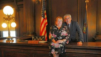 Katherine Emery and husband Gary Gilman, both Washington County Common Pleas Court judges, pose for a portrait inside Ms. Emery?s courtroom.