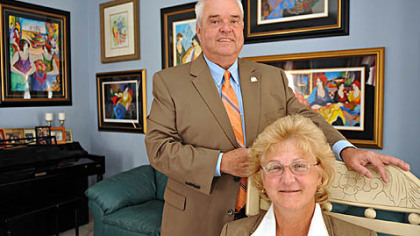 William and Monica Merrell in their Peters home. He is a Peters Township school board member; she is a councilwoman for the municipality.