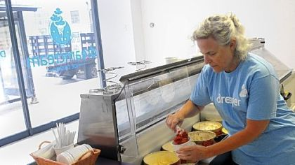 Naomi Herman, a volunteer for the American Liver Foundation, dishes up red velvet ice cream at  Dream Cream, a pop-up ice cream store on Liberty Avenue, Downtown.