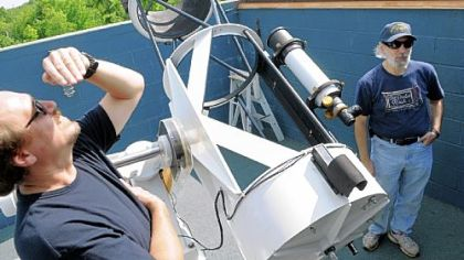 Tom Reiland, right, director of the Nicholas E. Wagman Observatory, explains the 21-inch Manka Memorial Telescope while Bill Yorkshire sneaks a peak at the sun.