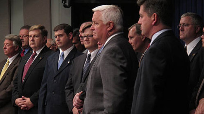 Gov. Tom Corbett, center, with Lt. Gov. Jim Cawley, lawmakers, and representatives of labor unions and business groups, gets ready Wednesday to begin a news conference designed to demonstrate support as he seeks legislative approval for a $1.7 billion tax break for the proposed cracker plant in Beaver County.