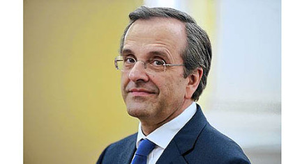 Newly elected Prime Minister Antonis Samaras looks on during his swearing-in ceremony Wednesday at the presidential palace in Athens.