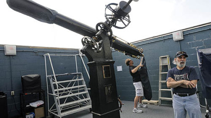 Bill Yorkshire, left, and Tom Reiland prepare the observatory's Brashear 11-Inch Refractor for use.