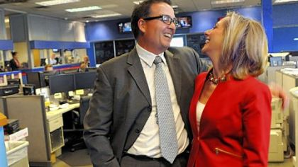 KDKA reporter Marty Griffin and wife KDKA anchor Kristine Sorenson talk in the newsroom last week.