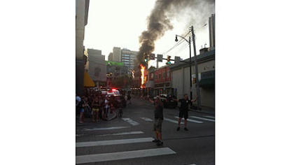 A fire burns on the corner of Oakland and Forbes avenues in Oakland.