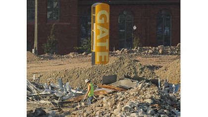 Signage for a gate of the Civic Arena stands alone during demolition operations.