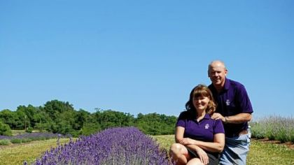 Nancy and James Cameron pose at Destiny Hill Farm, which has been in her family since 1941. The niche farm boasts more than 5,000 lavender plants in 17 varieties.
