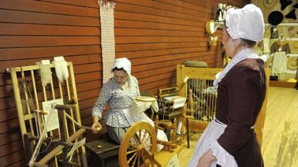 Sarah Carroll of Hampton, left, and Karen Parsons of Richland staff the Mercantile Center and demonstrate what parts of daily life would have consisted of in the18th century.