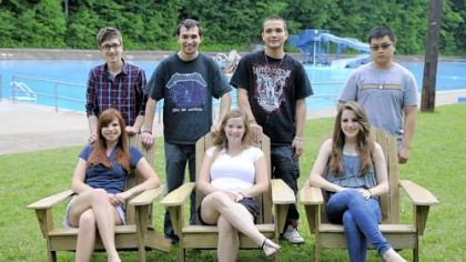 Students in Mike Magri's Technology Club from Keystone Oaks High School pose with the Adirondack chairs they made and donated to the Dormont Pool earlier this month.