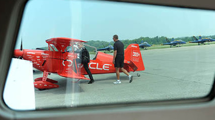 Pilots Sean D. Tucker, left, boards the Oracle Challenger 3 before a practice flight Thursday in preparation for this weekend's air show at the Westmoreland County Airport.