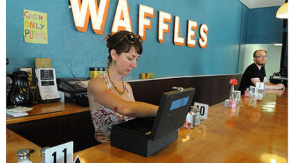 Courtney Ehrlichman gets ready behind the counter of the Waffle Shop in East Liberty.