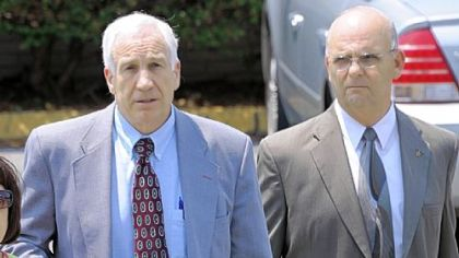 Jerry Sandusky leaves the Centre County Courthouse after the jury began deliberating his case Thursday afternoon.