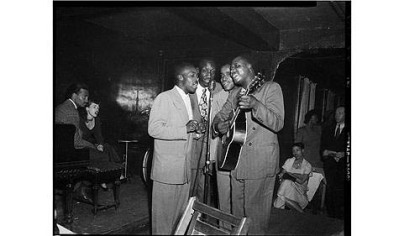 Four musicians perform at the Local 471 Musicians Club on Wylie Avenue in the Hill District, circa 1940-1950.