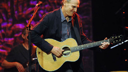 "James Taylor performs ""Country Roads"" in concert at the Petersen Center."