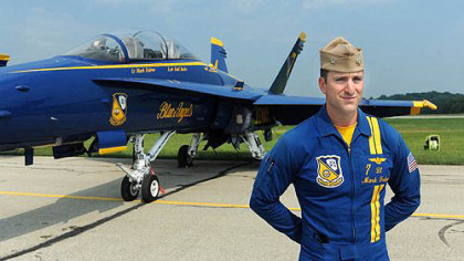 Blue Angels pilot and Charleroi native Lt. Mark Tedrow in front of his F-18 fighter jet Thursday at the Arnold Palmer airport.