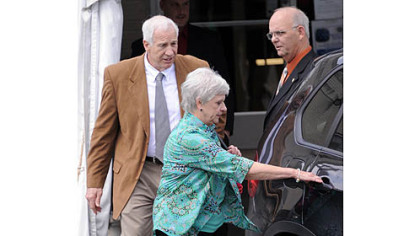 Jerry Sandusky and his wife, Dottie, leave the Centre County Courthouse after the jury deliberating his case heard testimony from witness Mike McQueary read to them in open court at their request Friday morning.