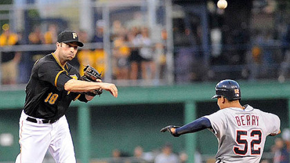 The Pirates&#039; Neil Walker checks off Detroit&#039;s Quintin Berry in the top half of a double play last night at PNC Park.
