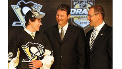 The Penguins pick Derrick Pouliot as their first round draft pick in the 2012 NHL Draft at the Consol Energy Center tonight in the Jordan Staal trade. At right, Penguins owner Mario Lemieux  and coach Dan Bylsma.