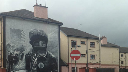 A mural on what is known as Free Derry Corner of a young boy with a gas mask and petrol bomb at the height of 1969 riots between Catholic residents and the Royal Ulster Constabulary.