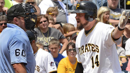 Pirates Casey McGehee argues the third strike with home plate umpire Marty Foster against the Tigers this afternoon at PNC Park.