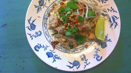 Phurit Saengthong-aram's Pad Thai, garnished with crushed peanuts,  cilantro and a wedge of lime.