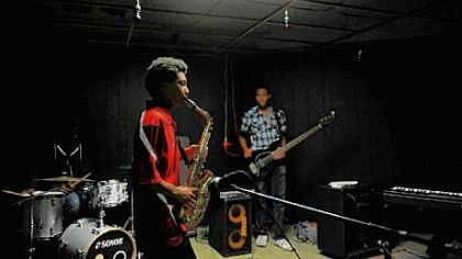 Ellis Durham, 14, of Monroeville plays the saxophone; David Watkins, 16, of Forest Hills plays bass guitar at the Center of Life in Hazelwood. The outreach has four jazz bands and an ensemble of rappers, dancers and singers.