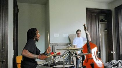Julian Powell, 22, of Braddock is on drums and Sam Harris, 18, of Point Breeze plays the bass. Performers earn and keep track of money as part of the outreach effort of the Center of Life.